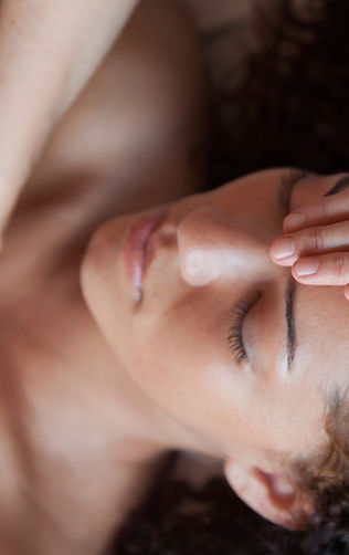 Woman receiving reiki treatment