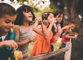 Preschool Kids Blowing Bubbles
