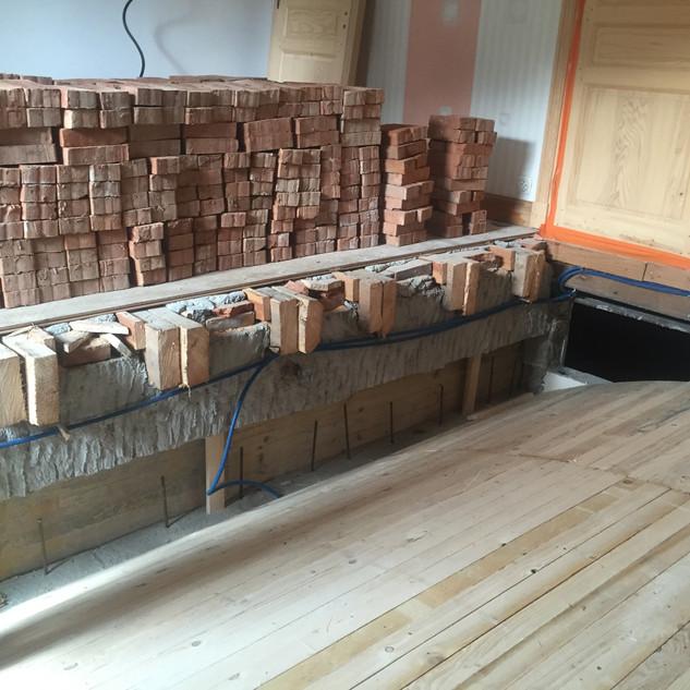 Préparation pour la pose des briques