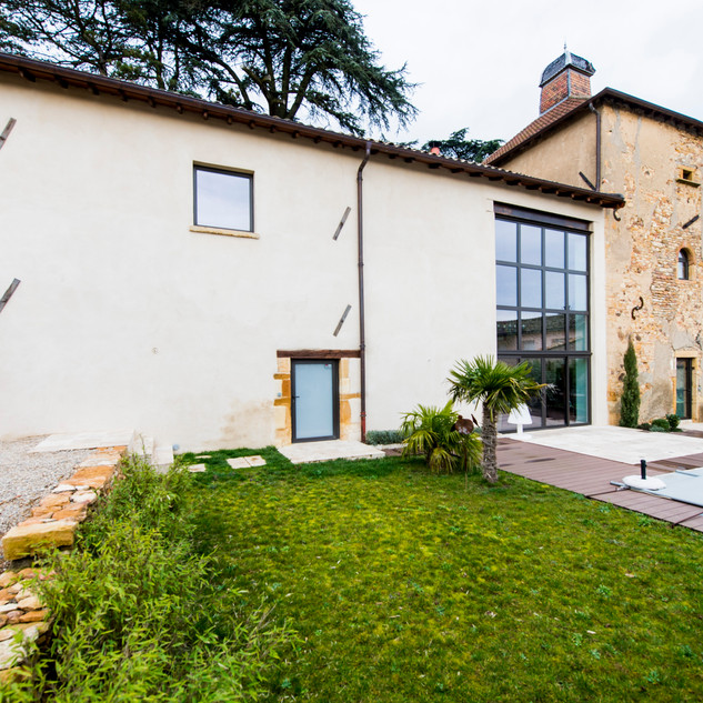 Réfection de la façade, terrassement et ouverture en verre