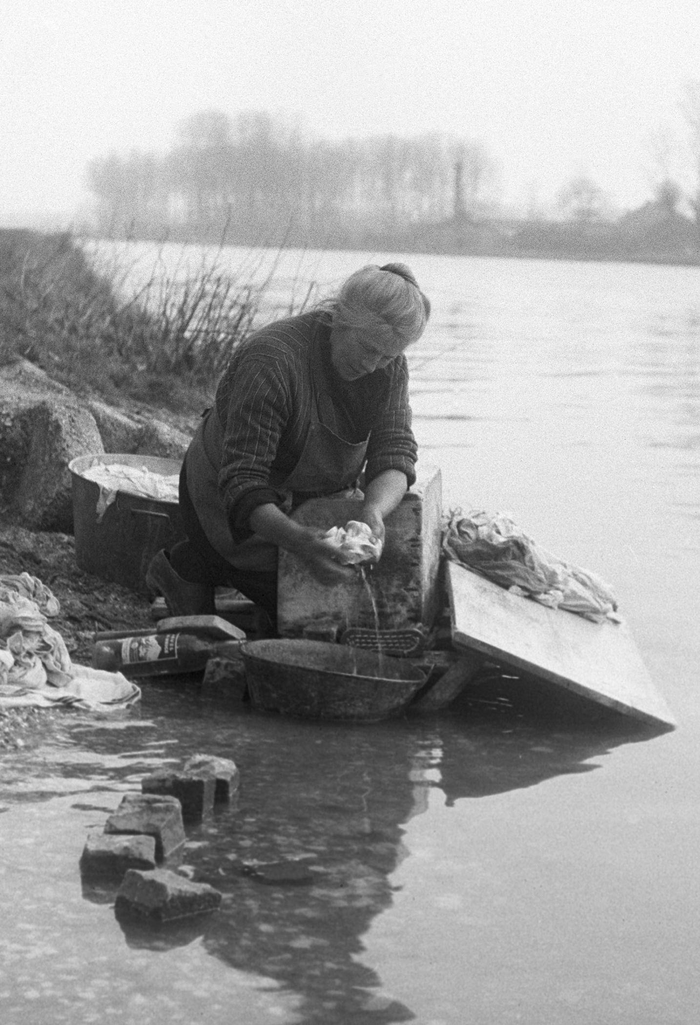 OLD WOMAN WASHING - 1949