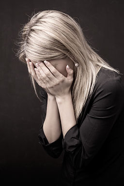 Sad Woman, Workplace Harassment, Personal Injury Lawyer Erie Pa, Tibor Solymosi Lawyer