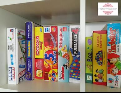 Rangement des boîtes de jeux de société à la verticale Portez Vous bien