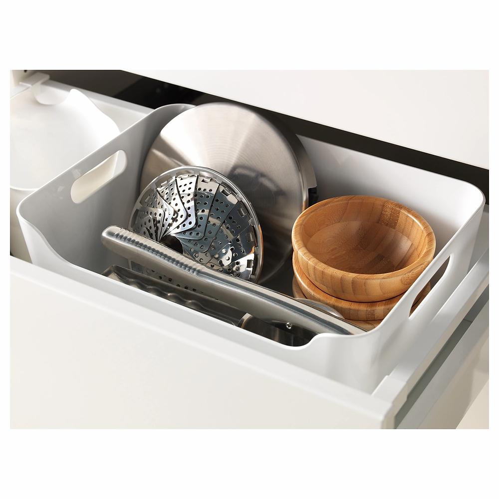 Portez Vous Bien rangement des couvercles de casseroles dans des bacs
