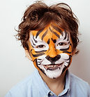 little cute boy with faceart on birthday