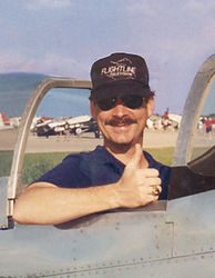 Author Jeff Burger sitting in a P51 Mustang