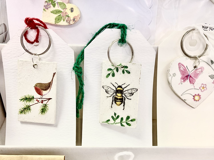 Keyrings, cards and necklaces - decoupaged wooden accessories.