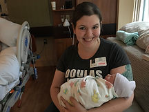 A kickass doula holding an adorable newborn
