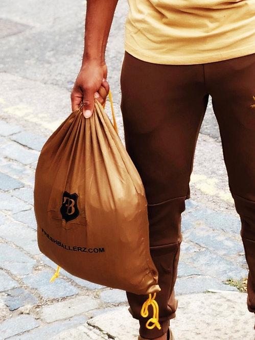 FB Drawstring Gold Backpack