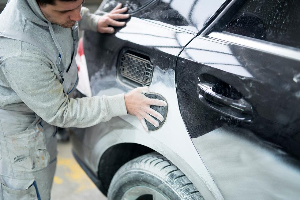 car-painter-preparing-car-painting-workshop.jpg