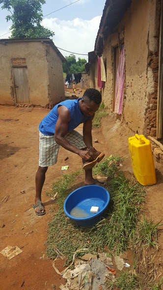 Sedrick visiting Nakivale and experiencing the daily washing situation.