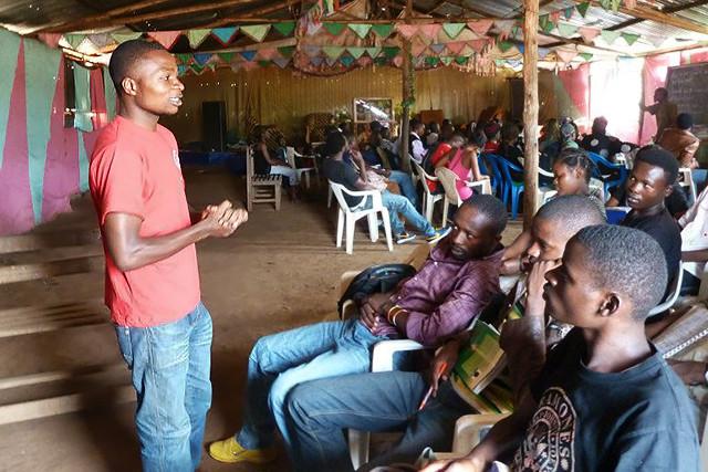 Sedrick teaching refugees English in Kampala