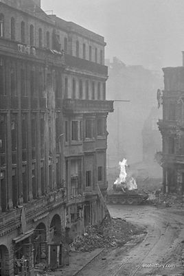 Obltn. Wilhelm Bartelborth's Panther catches fire in Cologne on March 6, 1945.