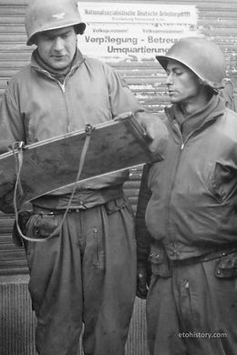 Col. Leander L. Doan (left) of Douglas, Arizona, and Lt. Col. Clifford L. Miller of Rochester, New York, study a map before driving to the center of Cologne, Germany. Doan commanded the 32nd Armored Regiment, and Miller commanded its Second Battalion.