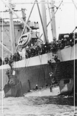 Second Battalion, 18th Infantry Regiment disembarks from USS Anne Arundel on D-Day.
