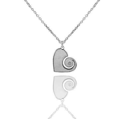 Silver stone set heart pendant set with a cubic zirconia