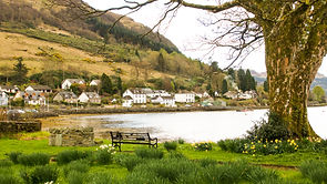View over the water of Loch Goil to the