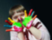 Cute little kid with painted hands.jpg
