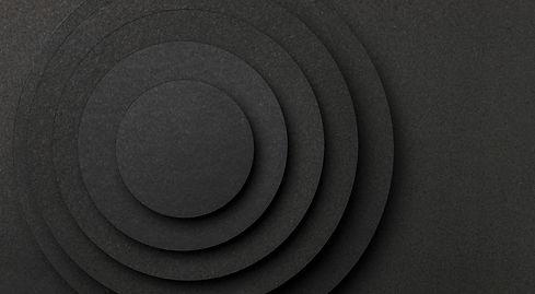 pyramid-circular-pieces-black-paper-copy-space.jpg