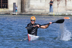 Surfski racer coming into the finish