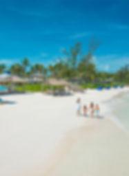 Family travel beach in the Caribbean