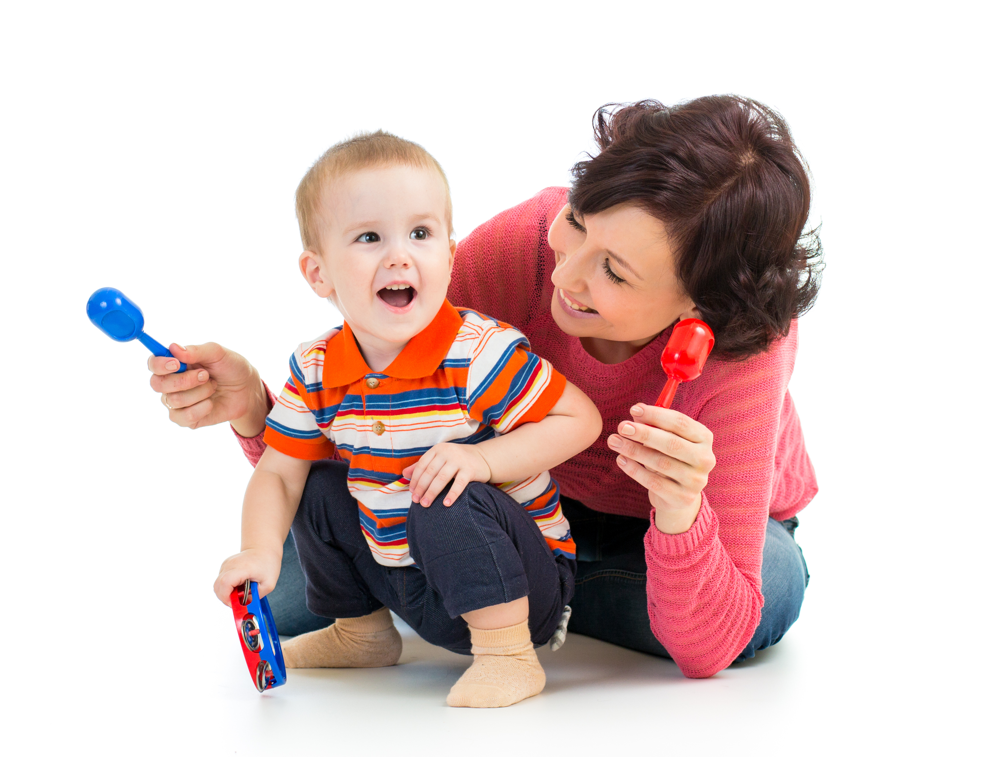 Mother and baby boy having fun with musi
