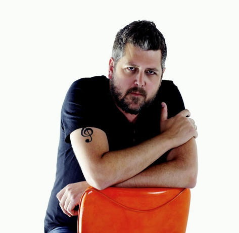 Simon Astley Orange Chair Pic.jpg