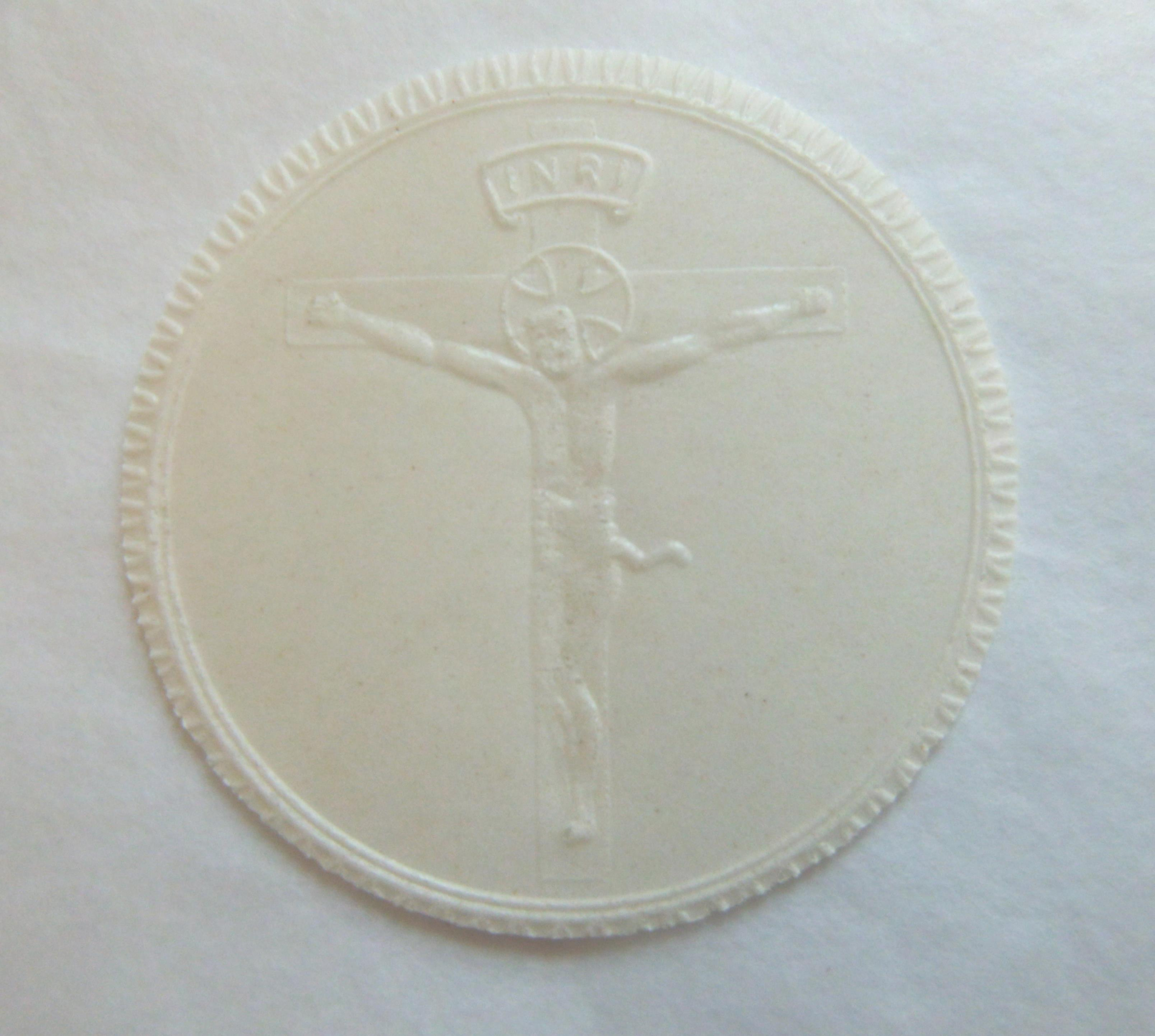 White crucifix priests bread