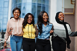 Four young college african american woma
