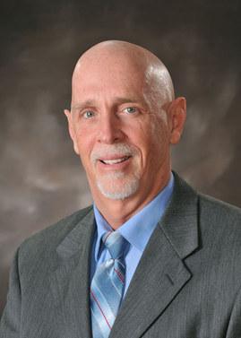 Dr. James J. Crawford