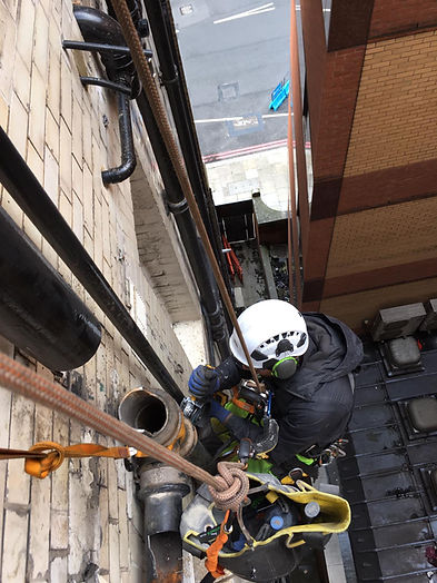 Abseiling cast iron pipe alterations