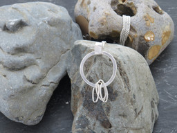 silver link with oval links and reticulated cuff on long chain