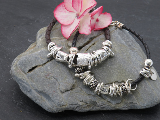 Leather Friendship Bracelets with various silver cuffs, charms and links