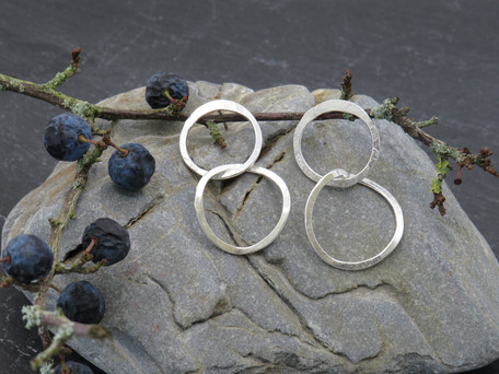 Large circle stud with twisted silver dangly link beneath