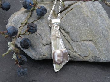 Bespoke curved reticulated pendant with grey/taupe freshwater pearl drop