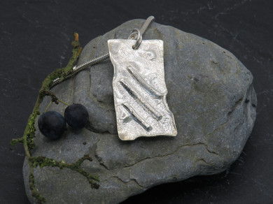 Large reticulated pendant with molten silver stripes