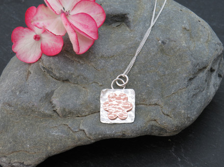 Hammered silver and copper daisy necklace (there are earrings to match)