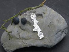 Long molten pendant