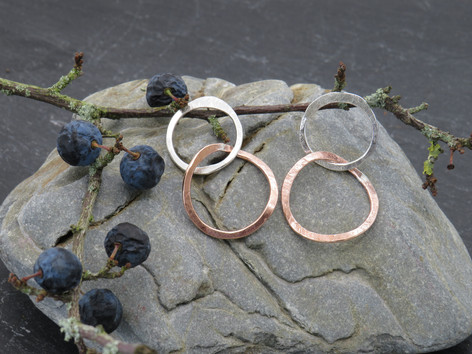 Large silver circle stud with twisted copper dangly link beneath