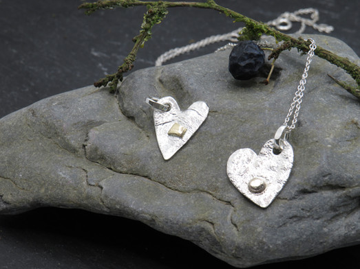 Reticulated silver heart with gold detaild