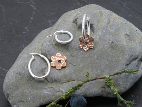Hammered copper daisy on oval fitting (but can be small round)