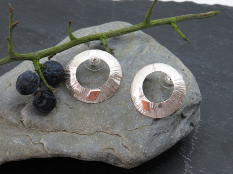 Barked effect silver slightly domed with copper details