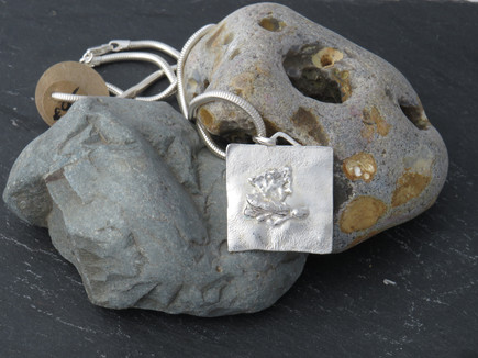 Square pendant with abstract fused silver centre