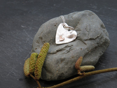 Silver reticulated heart with brass heart detail