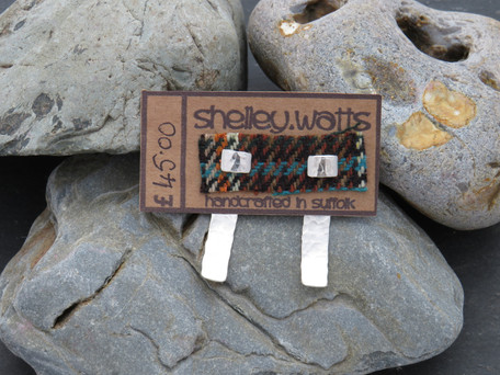Hammered D wire stud with slightly curved hammered separate back fitted over the post, this piece can be worn at the back of any studs