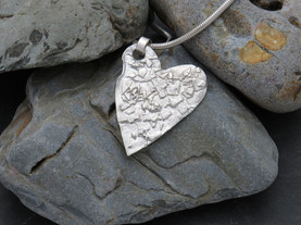 Large reticulated heart with fused silver pieces making it a unique piece On snake chain.