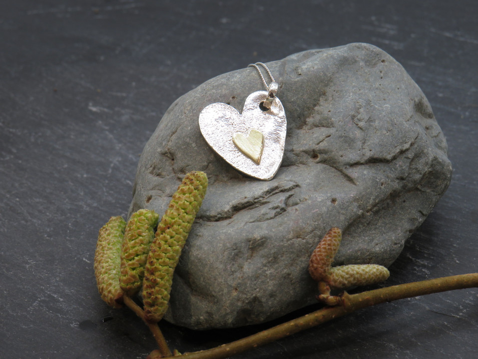 Silver reticulated heart with brass heart details
