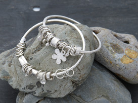 Jumble bangles on 3mm silver wire with a mixture of links, cuffs And charms making each one unique