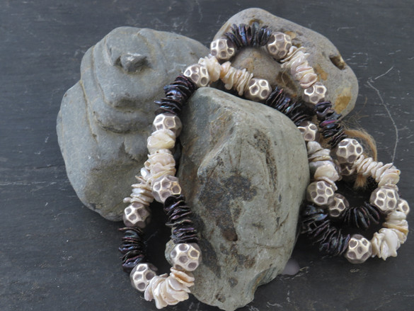 Long hand knotted necklace of Keisha freshwater pearls and Indian silver beads