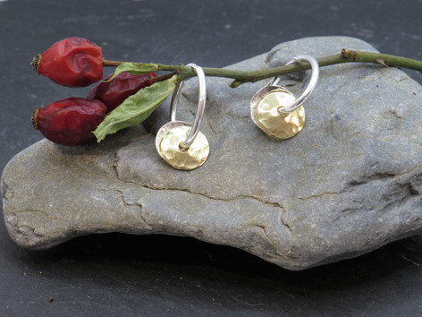 Oval silver creole with silver and brass discs